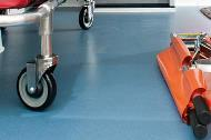 Plywood floor covered with non-slip medical vinyl